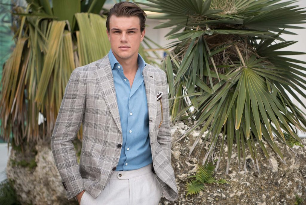 Consider fabric, color, and design when choosing a lightweight suit for hot weather