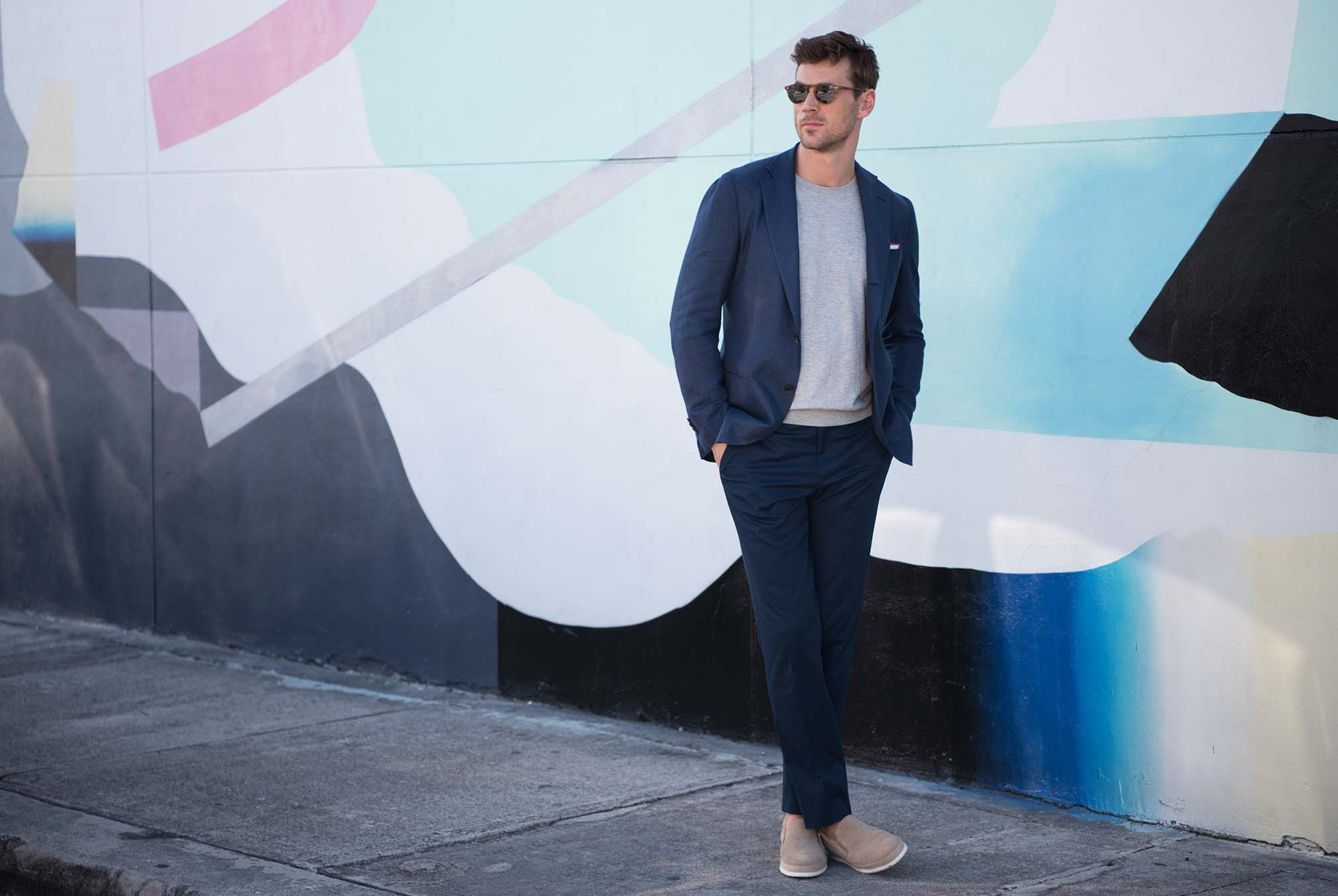 Pairing a suit and sneakers should look breezy and effortless