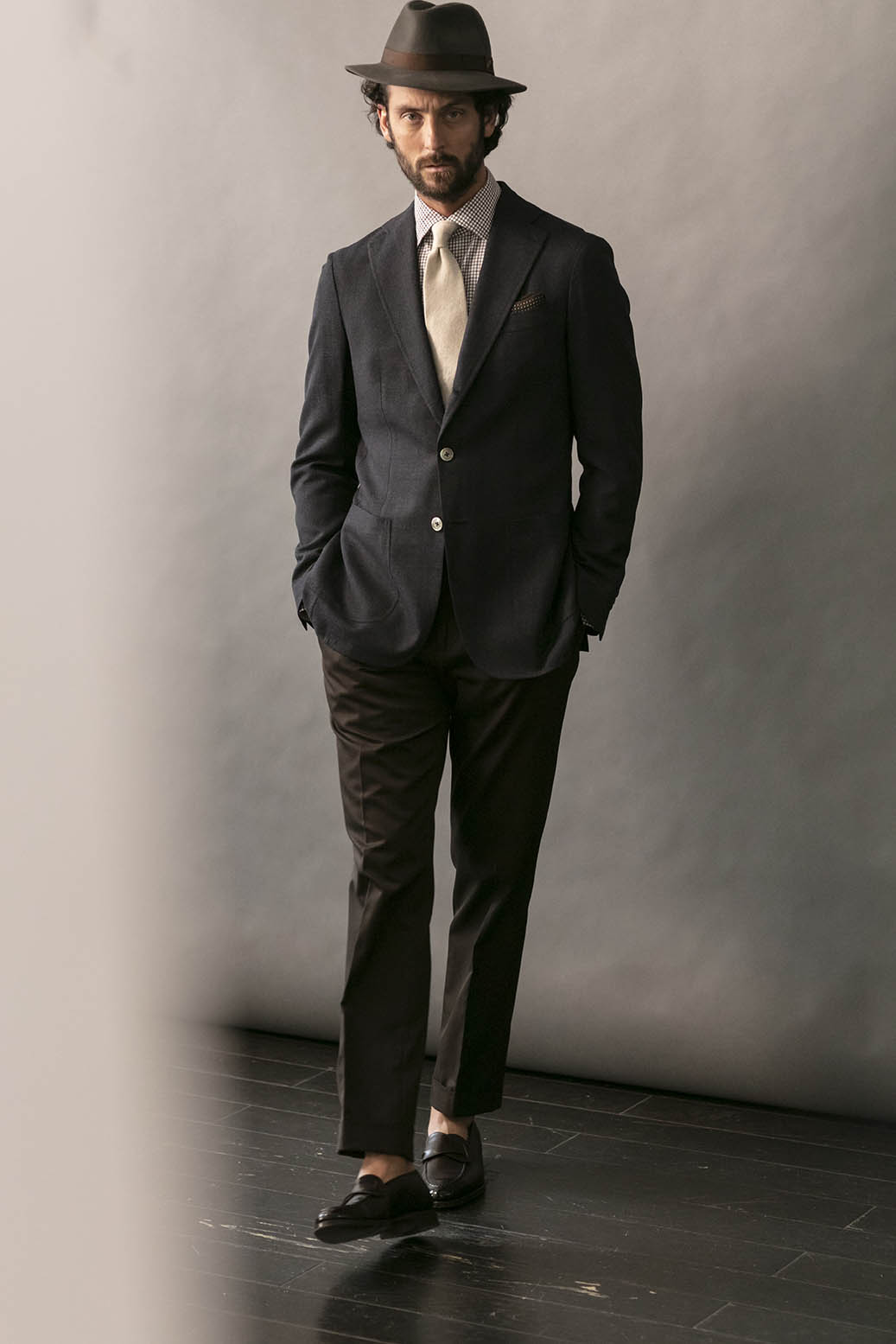 A variety of footwear pairs well with grey or brown suits